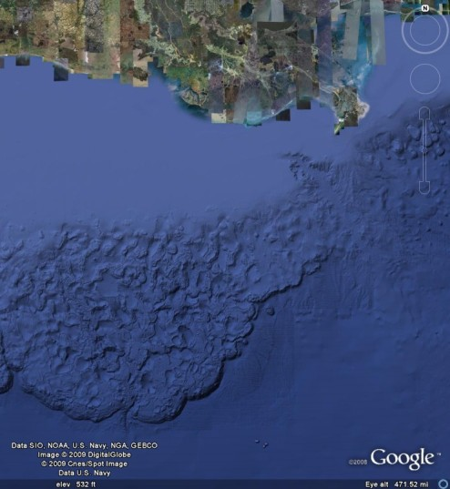 Gulf of Mexico. The irregular surface is formed by the rising of salt to form salt domes in some places, and dissolution of salt in others. The escarpment at the southern end of the chaotic area marks a thrust fault.