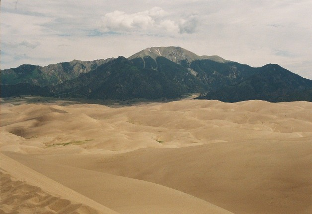 View of the Sangre de Cristo Mountains from High Dune, the second highest star dune in the dune field. The altitude at the top of the dune is near 9000 feet above sea level.