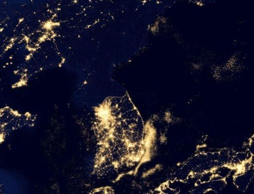 Korean Peninsula. Note the lights from fishing fleets off the coast of South Korea. Note also how dark North Korea is.